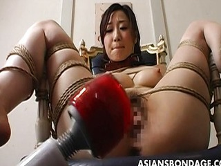 Extreme bondage coupled with dildo fuck for an Asian