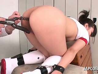 Brunette Japanese school chick gets ass and cunt toyed