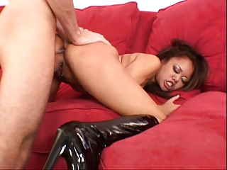 Submissive young asian in latex boots gets a hard doggy style pussy throbbing