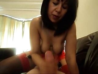 Asian matured lady gives handjob