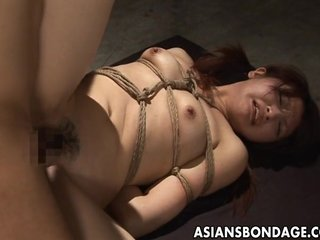 Tied up Japanese cutie stuffed with a thick h