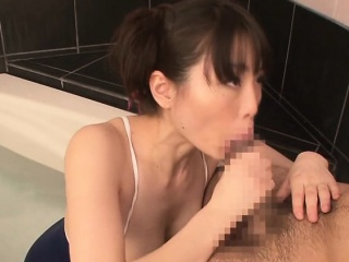 Japanese chick in hammer away bathroom sucking on a big cock
