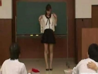 Japanese teacher reluctantly strips unfurnished with regard to front of students
