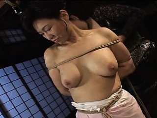 Mature trollop gets roped relating to and hung in a bdsm session