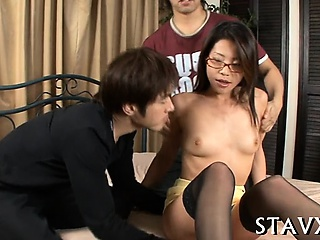 Lusty asian playgirl strokes in the first place her hirsute beaver naughtily