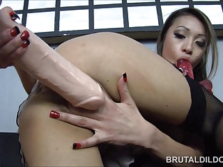 Asian with a big brutal dildo