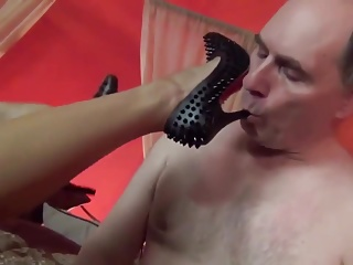 AsianMistress rest a slave licks with an increment of fondles her feet FemDom