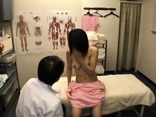 Fetching Japanese girl has a masseur fingering her queasy cunt