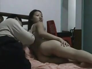 Appealing Chinese pair having intercourse