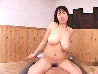 Sensuous Japanese masseuse with chunky natural hooters fucks a