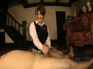 Cute Asian gal grabs his throbbing wanker added to gives him a h