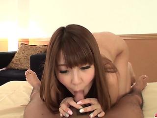 Hitomi Kitagawa uses jugs and mouth to stimulate cock