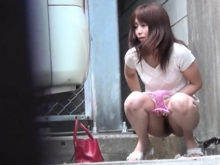 Asian watched pissing