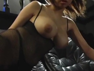 Solo Oriental descendant in fishnet stockings oral-fuckin A giant toy