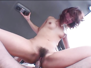Cruel Asian whore in stockings gets toy fucked while she sucks dick in cab