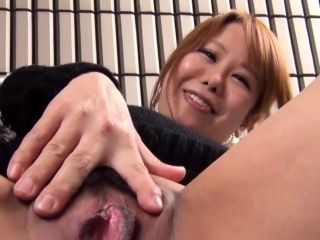Asian babe in arms strokes vag