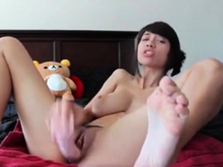 Horny Asian babe has a new man-made friend