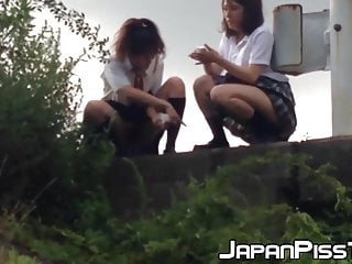 Schoolgirls from Japan peeing while taking a hike