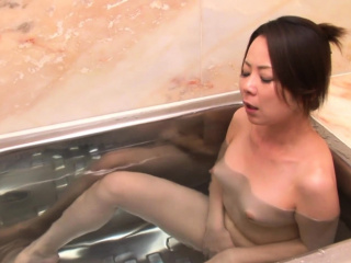 Naughty Asian unfocused fingers her pussy in an obstacle bathtub