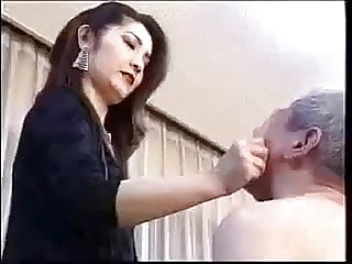 Asian slapping her slave impoverish