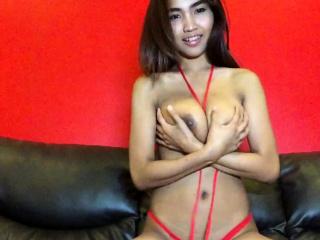 Big Interior Thai hottie strips red bikini