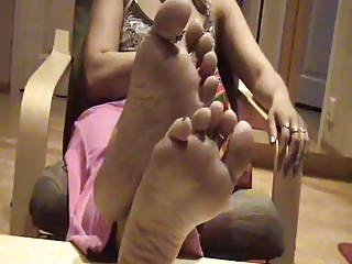 Gnawing away Chips and Showing gone her Soles