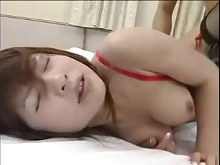 Busty Japanese is fucking a stiff cock and sucking on bed