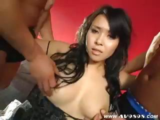Cute Asian bird gets between a span of cocks with the addition of gives fan