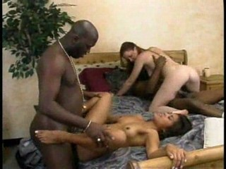 Two interracial couples having fun