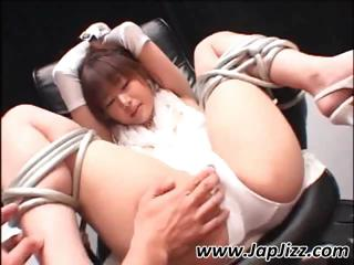 Asian girl is destined up hither legs spread wide getting her pussy fingered