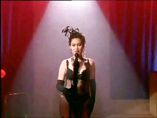 Tia Carrere connected with stockings and garter belt