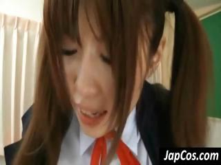 Young Japanese schoolgirl sits on the teachers blarney together with gets drilled