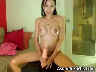 Sexy asian unlit pamper gets oiled
