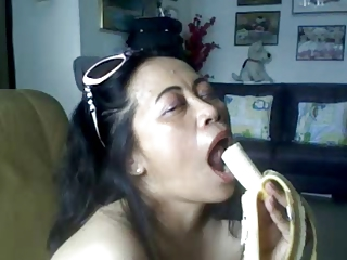 THAI MATURE LADY Exhibiting a resemblance HER BIG BOOBS AND SUCKING BANANA